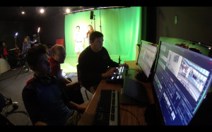 Mr. Waldrum supervises students during the live recording of the show'Tiller Vision,'  a magazine show highlighting school events and announcements
