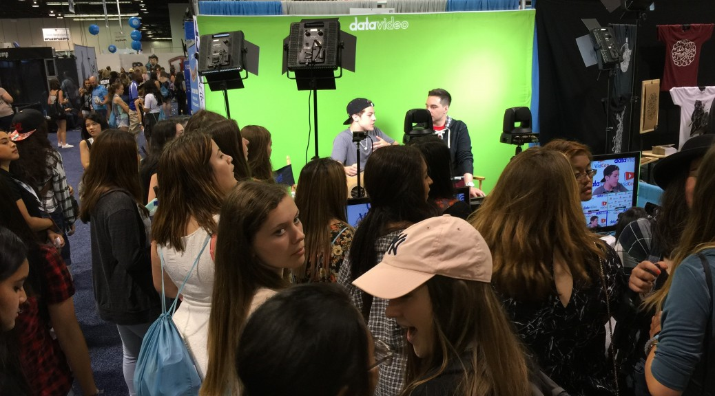 Fans gather for Reed Deming, a singer/songwriter of X Factor and YouTube fame, in his interview on Chris Trondsen's show live at the Datavideo booth.