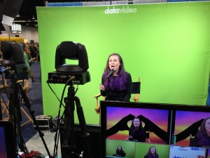 Spontaneously Sarah records an original song for  a music video at the Datavideo booth